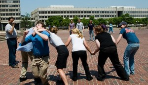Photo of adults in business casual playing Red Rover
